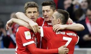 Bayern celebrate after Robert Lewandowski, centre, opened the scoring.