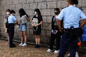 Hong Kong, China: Police stop and search supporters of Tong Ying-kit, the first person charged under a new national security law, during court hearing outside the high court