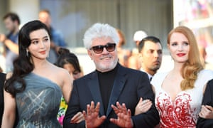 Cannes jury president Pedro Almodovar and actors Jessica Chastain and Fan Bingbing on the red carpet