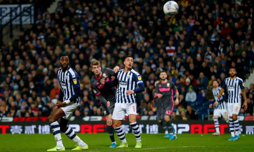 Patrick Bamford watches the ball as his header deflects in off West Brom's Semi Ajayi, to give Leeds a 1-1 draw
