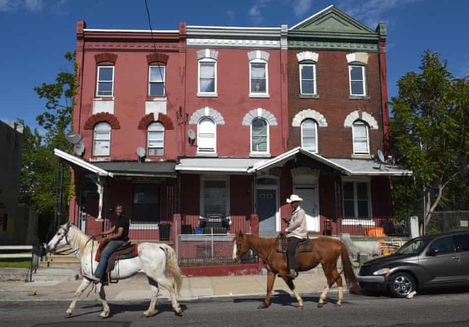 Horseman John Morris (right) and Chris Coger on the streets of Philadelphia.
