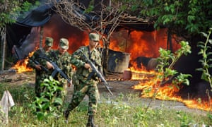 Colombian soldiers set fire to a cocaine processing laboratory in 2008