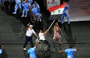 Flag bearer Mohamad Mohamad from the Syria Team waves his country's national flag