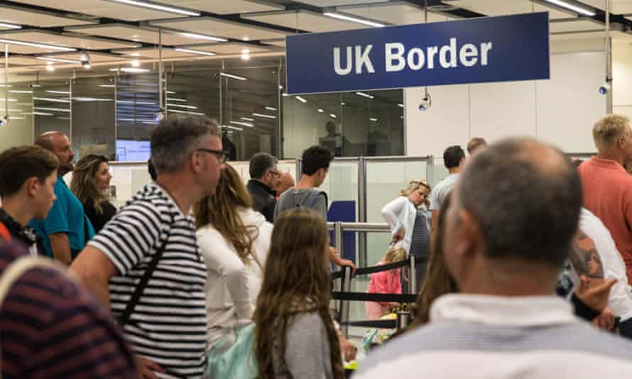 People queuing at the UK border immigration control at Gatwick.