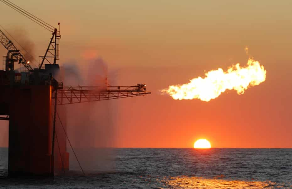 A flare from an ocean-based oil rig burning LNG