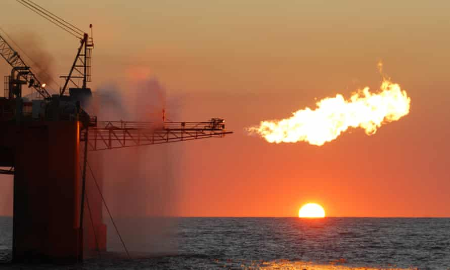 A flare from an ocean-based oil rig burning LNG as part of its exploration activities.