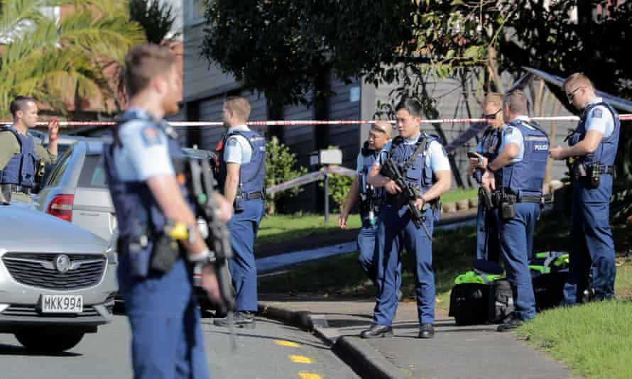 Armed police gather at the scene of a shooting following a routine traffic stop in Auckland
