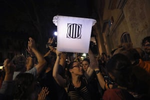 Barcelona, Spain. An election official carries an empty ballot box out of a polling station as the Catalan government holds a referendum vote on independence