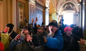Members of the violent mob in the Capitol building. Police fired teargas as the rioters pushed inside the gleaming white edifice.