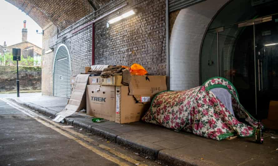 A cardboard shelter and tent for a homeless person under a railway arch in South London.
