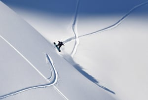 Fieberbrunn, Austria. Davey Baird of the US competes during the fourth stage of the men's snowboard event at the Freeride World Tour.