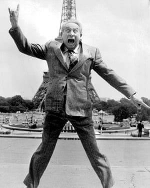 French singer and songwriter Charles Trenet, seen jumping in front of the Eiffel Tower in 1987.