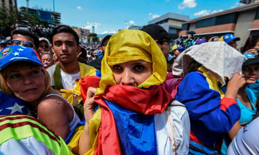 Opposition supporters listen to Juan Guaidó in Caracas on Saturday.