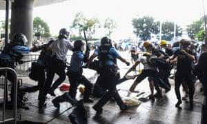 Police beat protesters outside the Legislative Council Complex