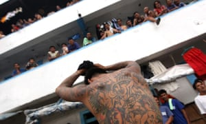 Bilibid prison south of Manila is home to around 26,000 inmates. Hundreds die of disease and stabbing.