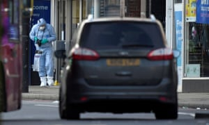 A police forensic officer at work near the site of the terror attack in Streatham, south London