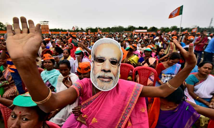 FILE PHOTO: A woman wearing a mask of PM Narendra Modi dances as she attends an election campaign rally being addressed by India's ruling BJP President Amit Shah at Ahatguri villageFILE PHOTO: A woman wearing a mask of Prime Minister Narendra Modi dances as she attends an election campaign rally being addressed by India's ruling Bharatiya Janata Party (BJP) President Amit Shah at Ahatguri village in Morigaon district in the northeastern state of Assam, India, April 5, 2019. REUTERS/Anuwar Hazarika/File Photo
