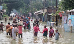 Indian residents wade through flood waters in Balurghat in West Bengal after torrential rain across India, Nepal and Bangladesh that killed hundreds of people