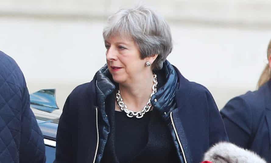 Theresa May arrives at Downing Street in London