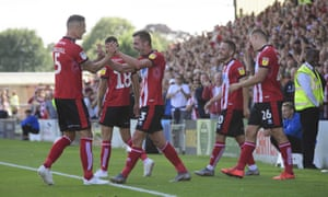 Lincoln City's players celebrate their second goal against Southend United.