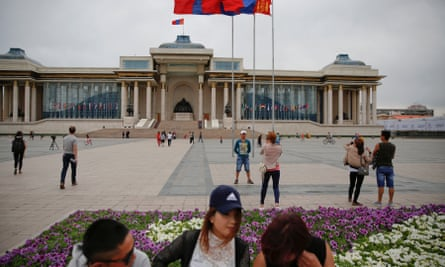 People pass time at Genghis Square in central Ulaanbaatar, Mongolia