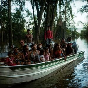 Munduruku indigenous tribe embark down the Tapajos river