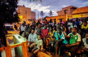 Senegalese supporters watch the Africa Cup of Nations 2019 final in a street in Medina.
