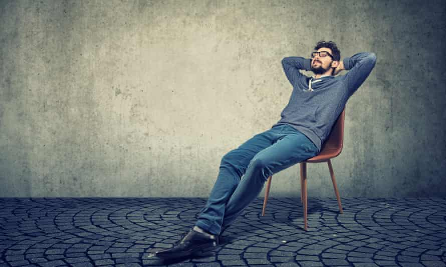 Man sitting on a chair and daydreaming