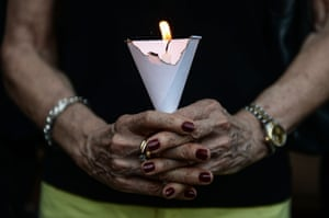Bankgkok, Thailand A member of the French community holds a candle during a vigil