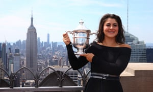 Bianca Andreescu poses with her trophy at the Top of the Rock in Rockefeller Center in New York