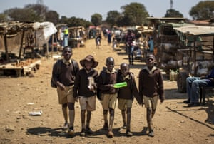 Harare, Zimbabwe: Schoolboys return home on the first day of the school term in Kuwadzana, on the outskirts of the capital