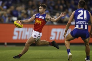 Lachie Neale of the Lions kicks the ball during the Round 2 AFL match between the North Melbourne Kangaroos and the Brisbane Lions at Marvel Stadium.