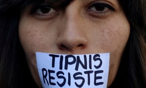 An activist with a sign pasted on her mouth urging to resist Bolivian government plans for stripping Tipnis of its protected status.