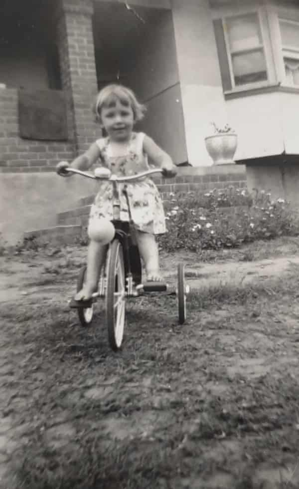 Writer Christine Sykes on her tricycle outside her family home in Cabramatta.
