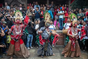 Masked dancers perform on the first day of the Indra Jatra festival in Basantapur Durbar Square, Kathmandu