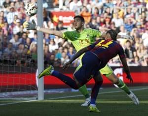 Barcelona's Neymar heads the opening goal past Real Sociedad goalkeeper Rulli