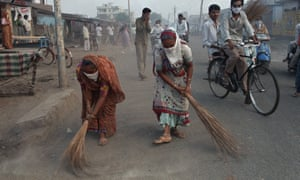 Sweepers clean the streets during a plague epidemic in Surat in 1994.