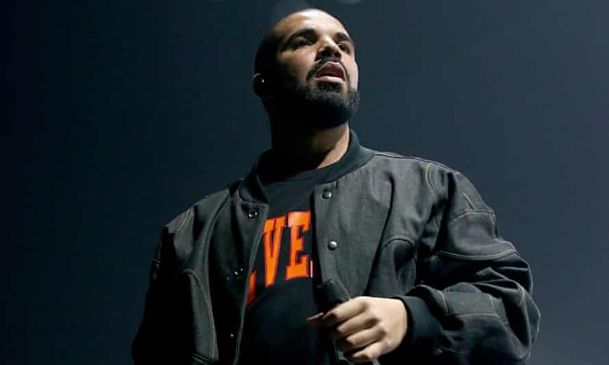 Drake sporting one of the 'Revenge' t-shirts on sale at the pop-up