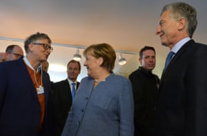 Bill Gates (left) meeting German Chancellor Angela Merkel and Argentina's President Macri during the World Economic Forum (WEF) annual meeting in Davos today.