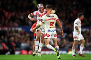 Tommy Makinson of St Helens celebrates with teammate Theo Fages after kicking a late drop goal.