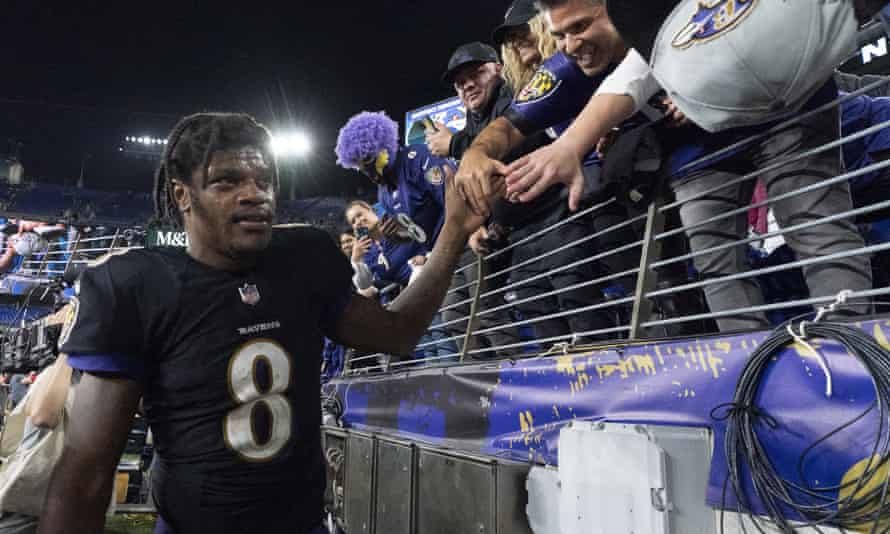 Baltimore Ravens quarterback Lamar Jackson celebrates with fans after their win over the Colts.