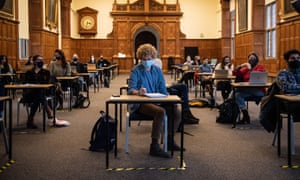 Masked students sit in a socially distanced class at the University of Oxford last November.