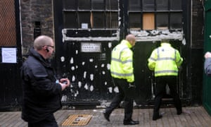Bailiffs prepare to enter a Mayfair property to carry out an eviction: squatters have carried out a number of high-profile occupations of empty buildings in the area in recent years.