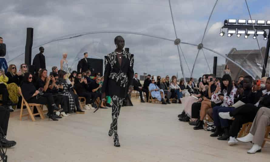 A bejewelled model walks the runway.