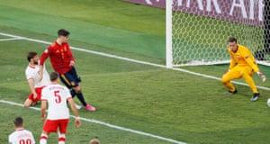 Spain's Alvaro Morata scores their first goal.