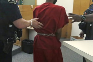 Dawit Kelete wears handcuffs chained to his waist as he walks out of a court appearance. Kelete is accused of driving a car into a Black Lives Matter demonstration on Interstate 5 in Seattle and hitting two protesters, killing one