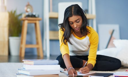 ◀ Give your budding student as much help or space as they need when they're choosing their course photograph: gettyShot of a young female student studying at home