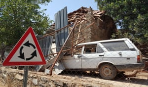 A damaged car and house in the village of Yalıçiftlik near the resort town of Bodrum in Muğla province, Turkey