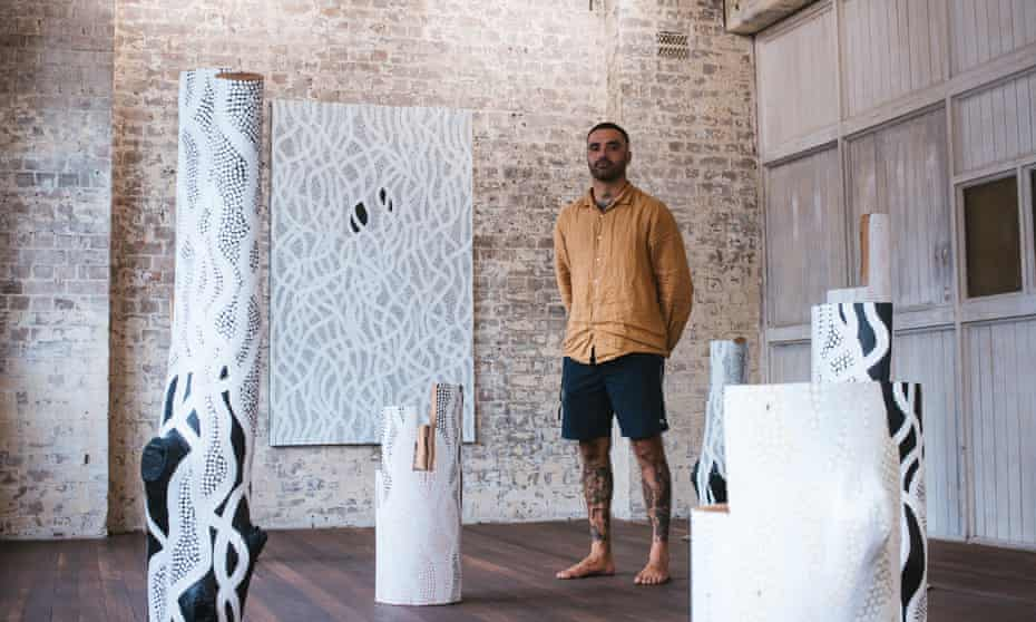 Otis Hope Carey, surfer and artist, at the installation of his 2021 exhibition at China Heights Gallery in Sydney.