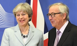 Theresa May is welcomed by European commission president Jean-Claude Juncker in Brussels.